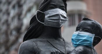 People are putting face masks on statues across the world to promote social distancing