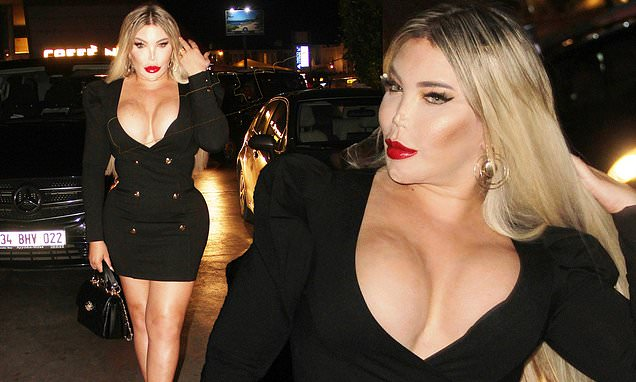 Jessica Alves puts on an eye-popping in a busty black mini dress during a night out in Turkey