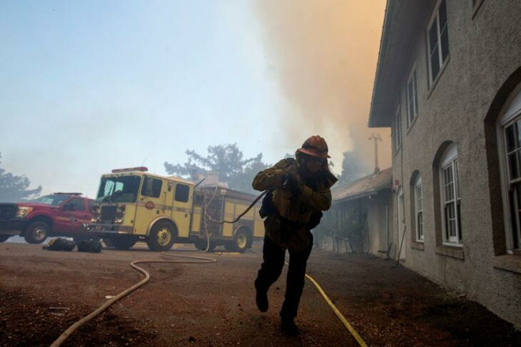 California firefighters race to subdue flames before heat and winds return – Reuters